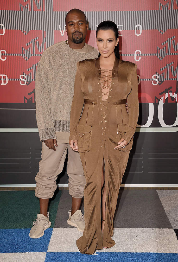 LOS ANGELES, CA - AUGUST 30:  Rapper Kanye West (L) and TV personality Kim Kardashian attend the 2015 MTV Video Music Awards at Microsoft Theater on August 30, 2015 in Los Angeles, California.  (Photo by Steve Granitz/WireImage)